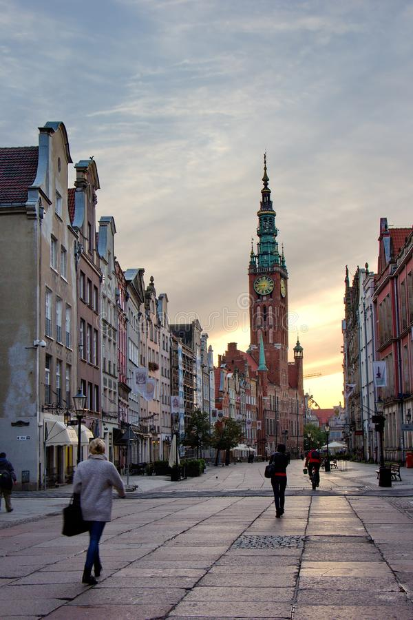 Gdansk, Poland -september19, 2017: sunrise on Dluga street, view on renewed houses and city hall. Gdansk, Poland -september 19, 2017: sunrise on Dluga street royalty free stock image