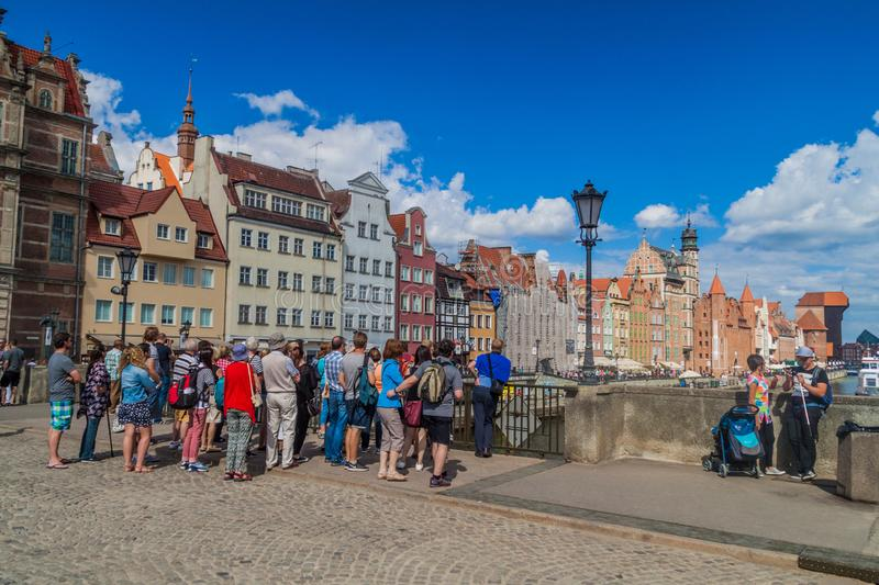 GDANSK, POLAND - SEPTEMBER 2, 2016: Tourists on Green Bridge over Motlawa river in Gdansk, Polan stock image
