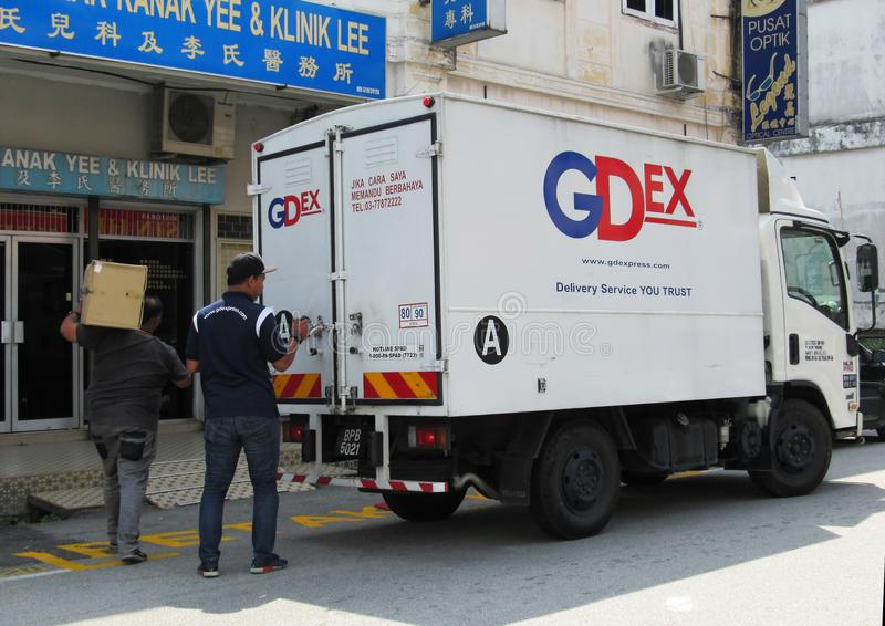 GDExpress Employees Out On Delivery. Delivery men from one of Malaysia`s leading courier companies GDExpress or GDEx out on delivery royalty free stock photos