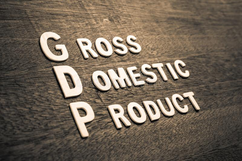 GDP Wood Letters. GDP abbreviation with text Gross Domestic Product by wood letters on wood background stock photo