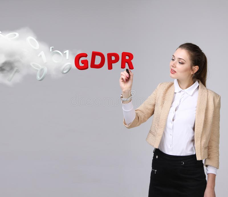 GDPR, concept image. General Data Protection Regulation, the protection of personal data. Young woman working with stock photography