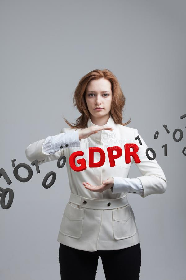 GDPR, concept image. General Data Protection Regulation, the protection of personal data. Young woman working with stock photos