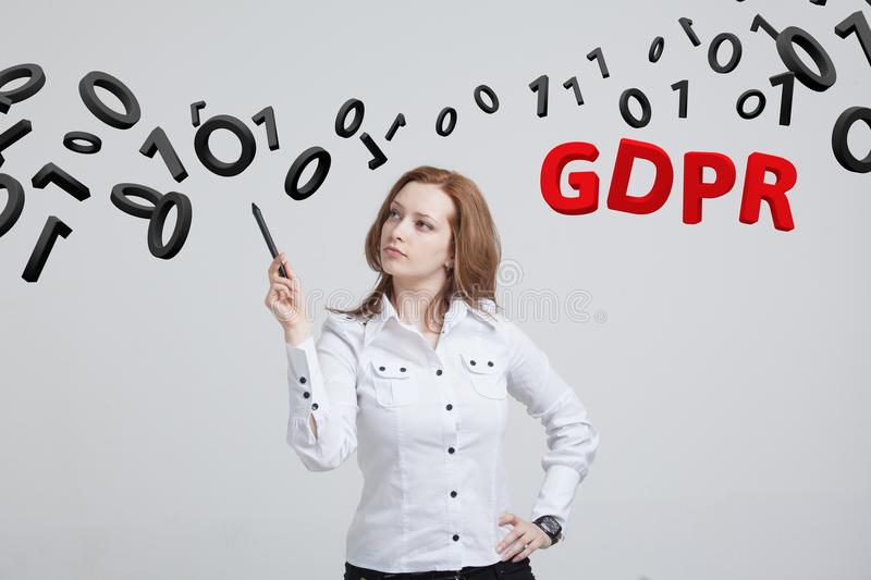 GDPR, concept image. General Data Protection Regulation, the protection of personal data. Young woman working with stock photo