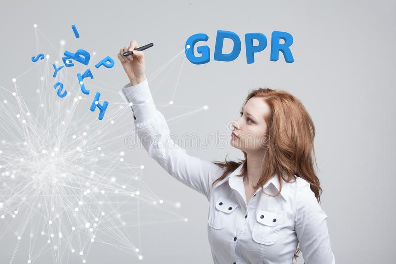 GDPR concept image. General Data Protection Regulation, the protection of personal data. Young woman working with stock photo