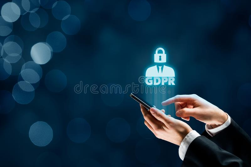 GDPR concept. GDPR general data protection regulation concept. Businessman or IT technologist with text GDPR and icon of people and lock instead of head royalty free stock photo