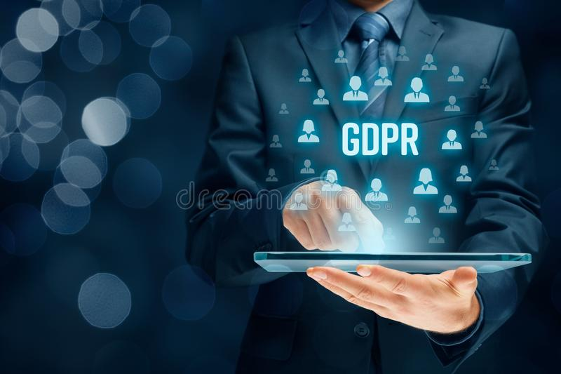 GDPR concept. GDPR general data protection regulation concept. Businessman or IT technologist with text GDPR and icons of people royalty free stock photos