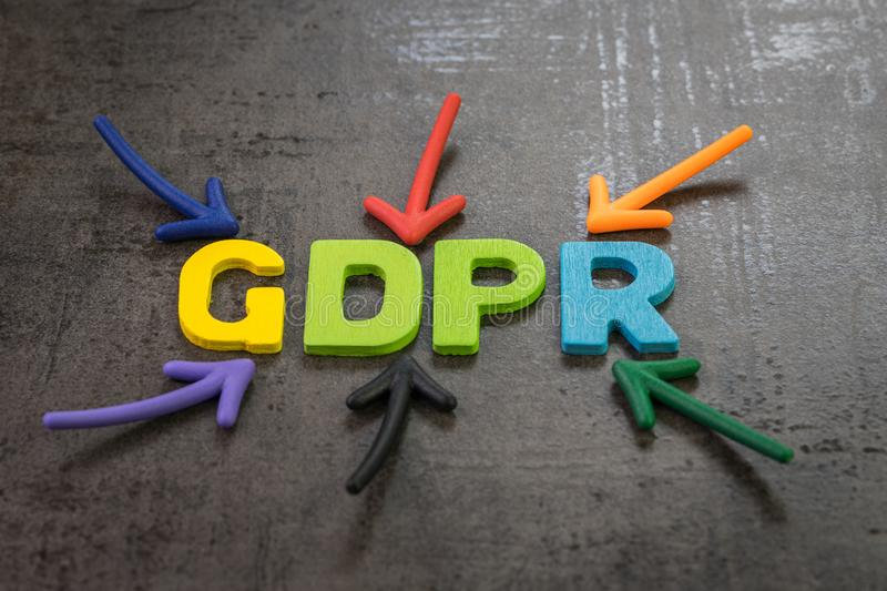 GDPR, General Data Protection Regulation concept, colorful arrows pointing to the word GDPR at the center of black cement. Chalkboard wall, important Europe royalty free stock image