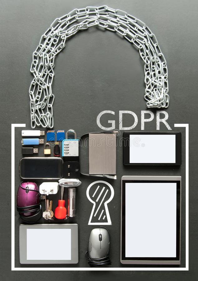 GDPR general data protection regulation padlock concept. GDPR handwritten inside a padlock made from various devices including tablets, computer mouse, usb cards stock photography
