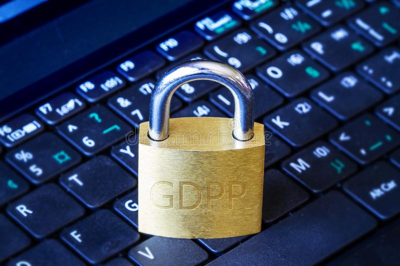 GDPR Padlock on Keyboard Data Protection Concept. Golden padlock with GDPR engraved on computer laptop keyboard. Concept of General Data Protection Regulation stock images