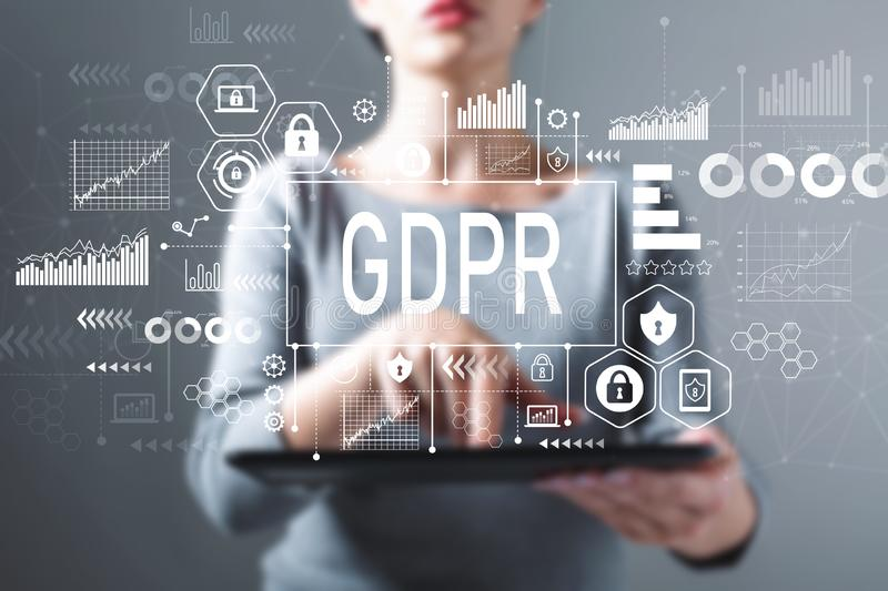 GDPR with woman using a tablet. GDPR with business woman using a tablet computer stock photo