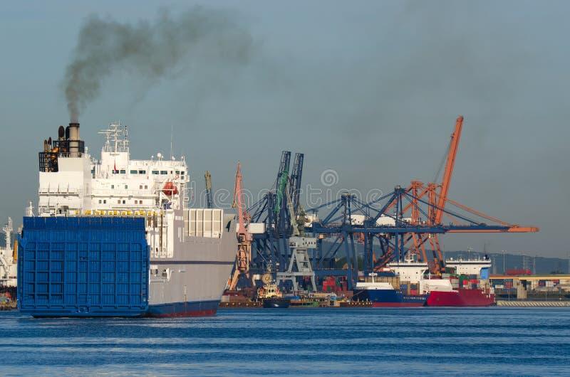 GDYNIA - MERCHANT SHIP ENTERING THE PORT royalty free stock photo