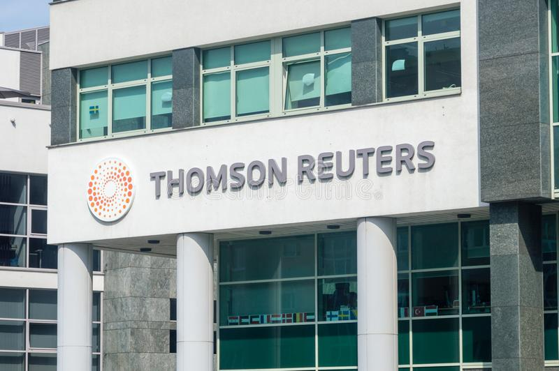 Logo and sign of Thomson Reuters Corporation. Gdynia, Poland - August 2, 2018: Logo and sign of Thomson Reuters Corporation. Thomson Reuters is a Canadian royalty free stock images
