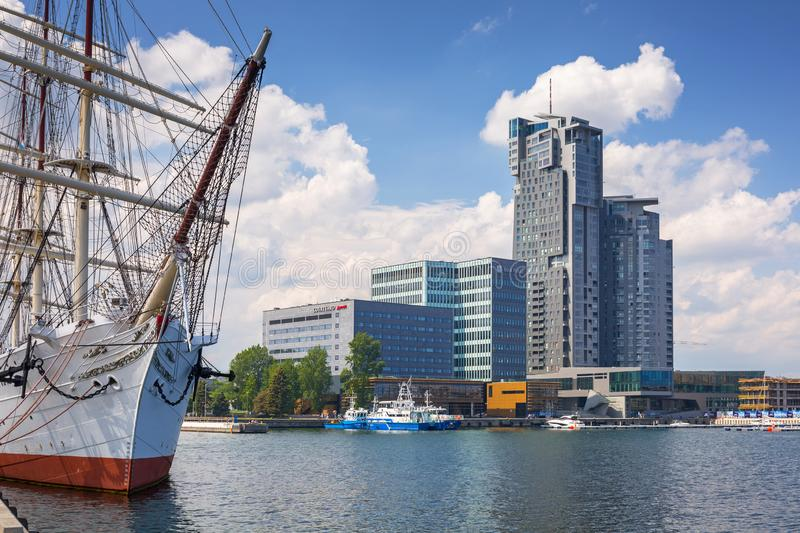 Gdynia, Poland - June 8, 2019: Polish frigate Dar Pomorza at the Baltic Sea with Sea Towers skyscraper in Gdynia royalty free stock images