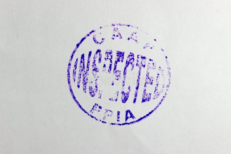 Geïnspecteerd verbinding die op een kaartje wordt gestempeld stock foto's