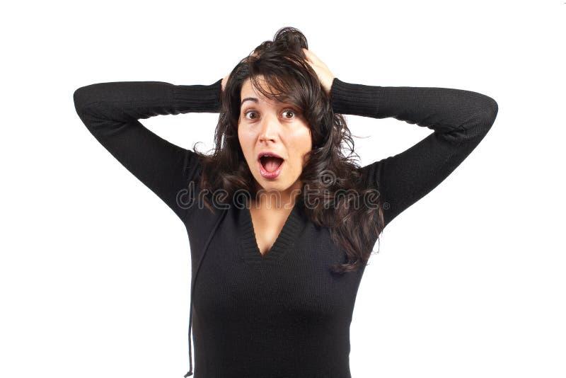 Geïrriteerde jonge vrouw stock afbeelding