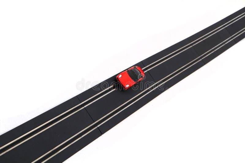 geïsoleerd het vervoersstuk speelgoed van het spoorras stock foto's