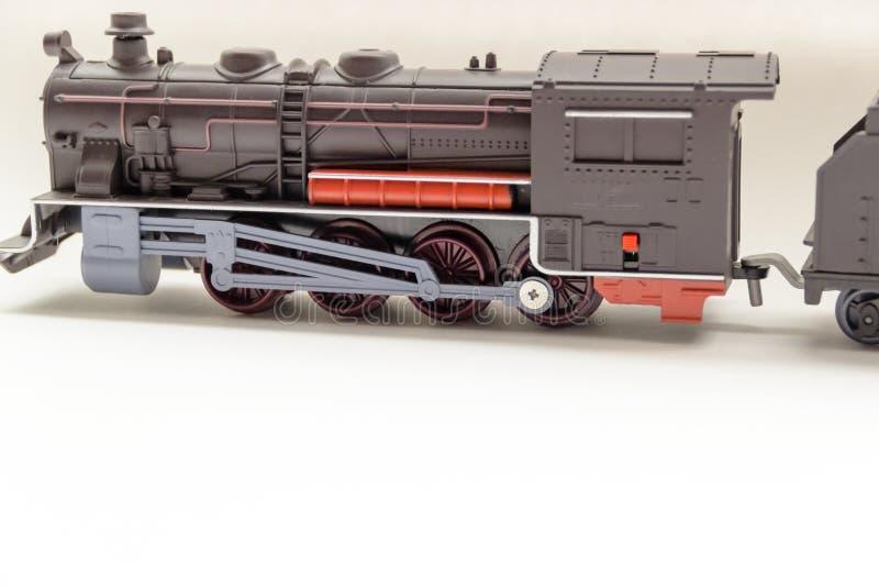 Geïsoleerd model van oud trein voortbewegingsstuk speelgoed royalty-vrije stock afbeelding