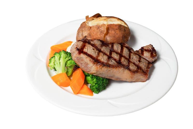 Geïsoleerd op witte steak, aardappel en groente stock foto