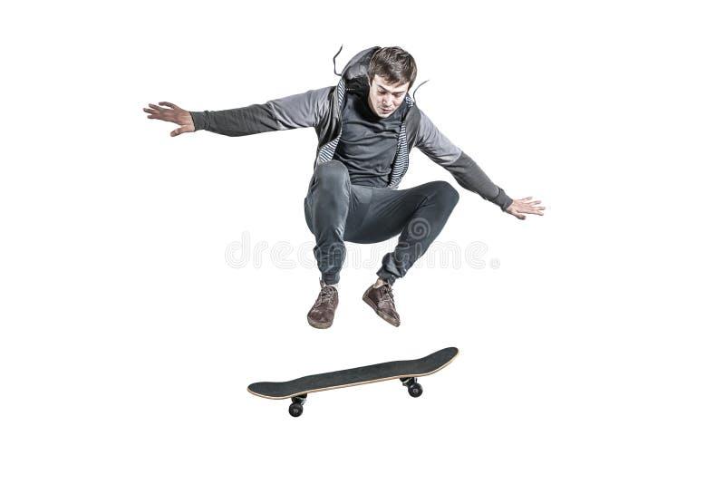 Geïsoleerd springen skateboarder stock foto's