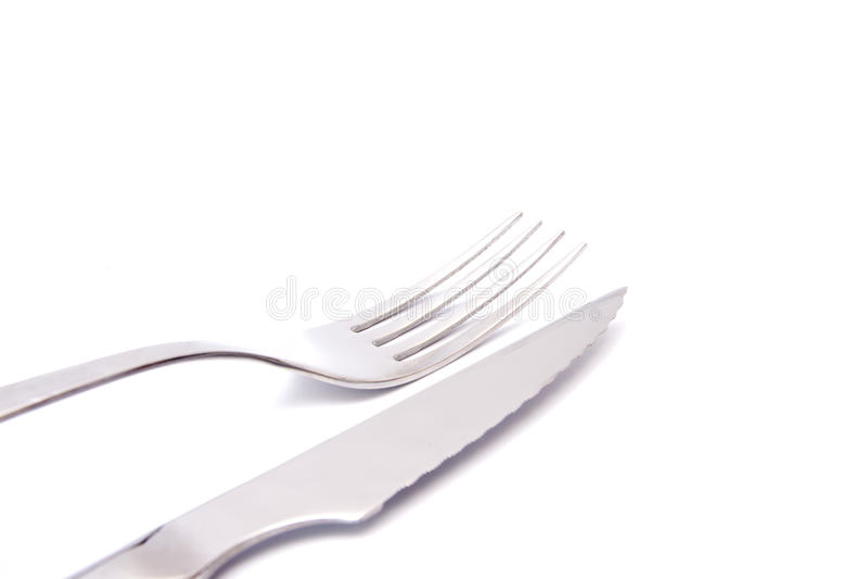Geïsoleerdd mes en vork stock afbeelding