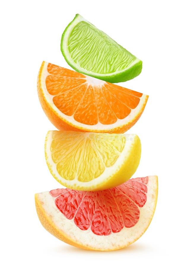 Geïsoleerde citrusvruchtenplakken in een stapel stock afbeelding