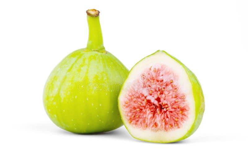 Geïsoleerde fig., gesneden en vers royalty-vrije stock afbeelding