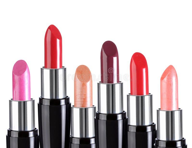Geïsoleerde groep kleurrijke lippenstiften royalty-vrije stock afbeelding