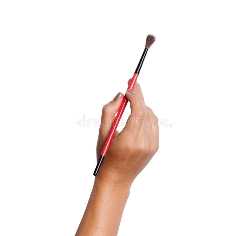 Geïsoleerde hand die een penseel houden Borstel het schilderen op witte achtergrond royalty-vrije stock foto's