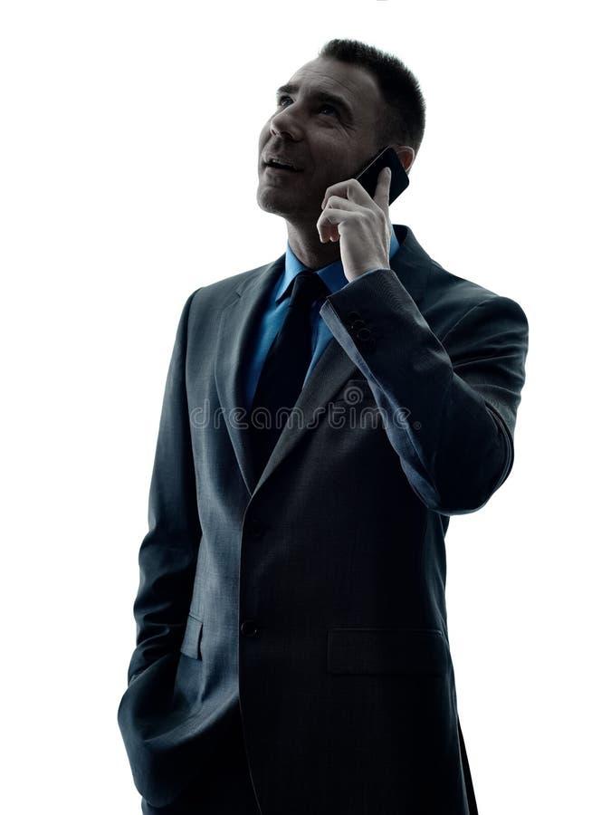 Geïsoleerde het silhouet van de bedrijfsmensentelefoon royalty-vrije stock afbeeldingen