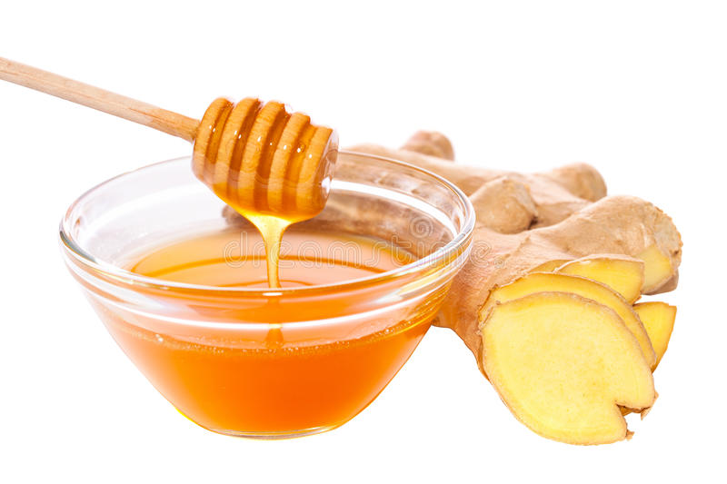 Geïsoleerde honing en gember royalty-vrije stock afbeelding