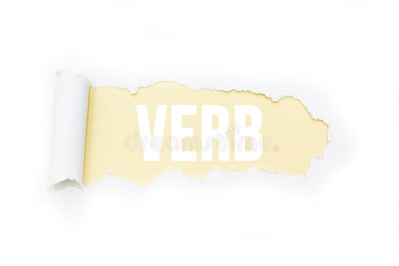 Geïsoleerde inschrijving 'werkwoord 'op een gele achtergrond, tearing document stock afbeeldingen