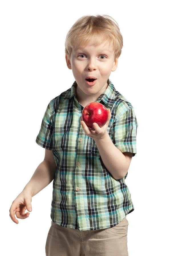 Geïsoleerde jongen met appel stock afbeeldingen
