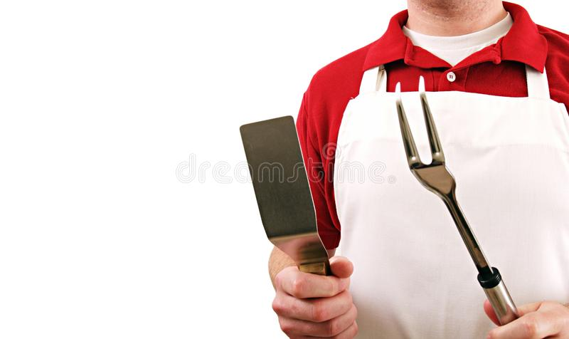 Geïsoleerde kok met werktuigen stock fotografie