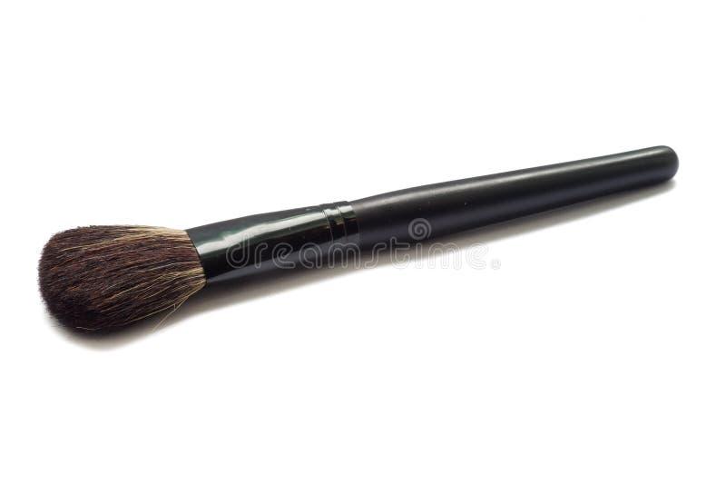 Geïsoleerde make-upborstel stock fotografie