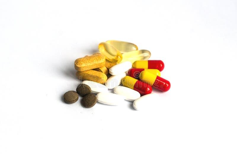 Geïsoleerde pillen stock foto's