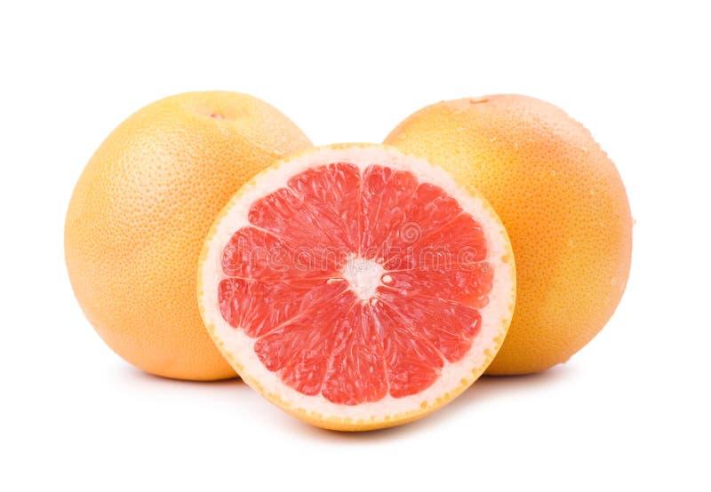 Geïsoleerde rijpe grapefruit en plak royalty-vrije stock afbeeldingen