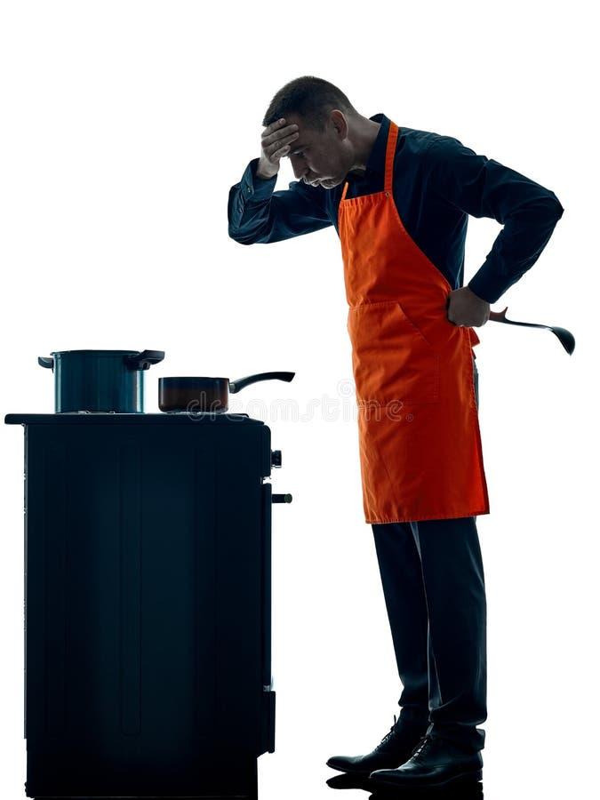 Geïsoleerde silhouet van de mensen het kokende chef-kok royalty-vrije stock foto's