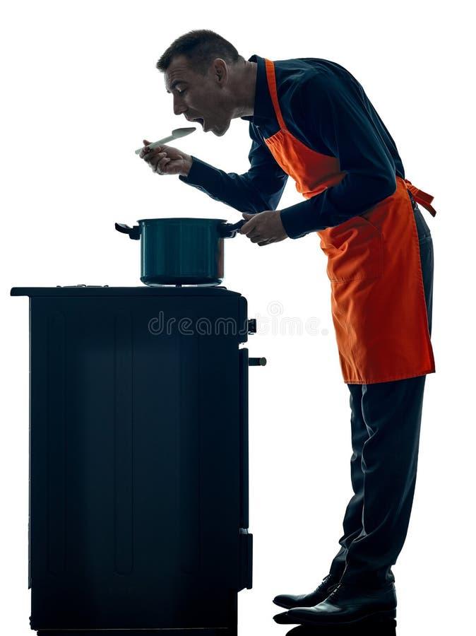 Geïsoleerde silhouet van de mensen het kokende chef-kok royalty-vrije stock afbeeldingen