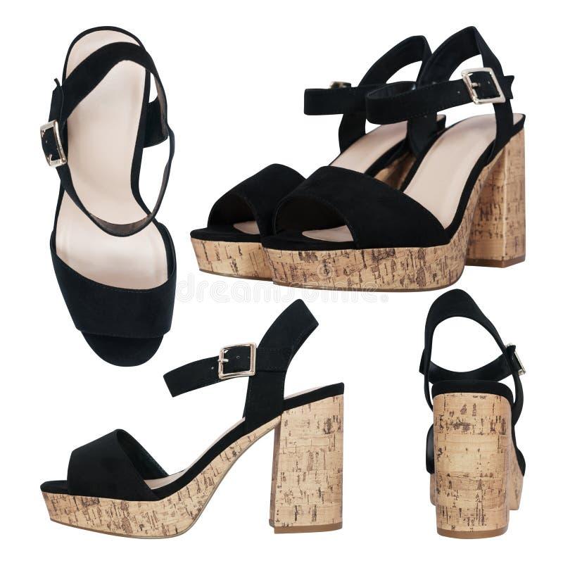 Geïsoleerde suède zwarte vrouwelijke sandals royalty-vrije stock fotografie