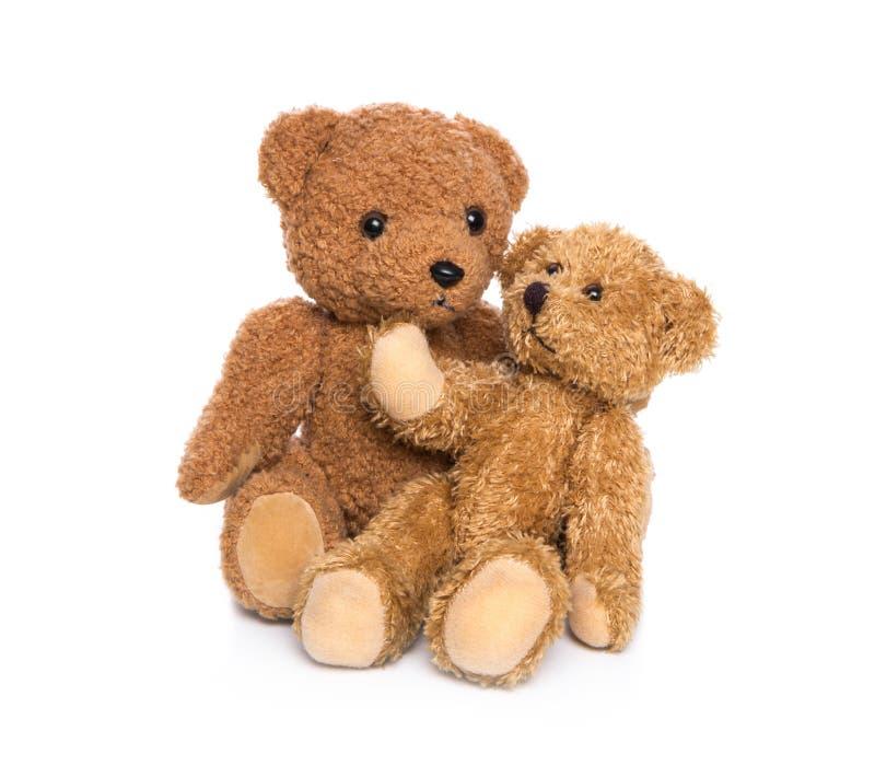 Geïsoleerde teddyberen: het krijgen van een baby. stock foto
