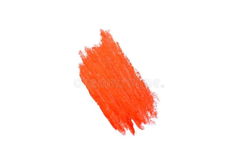 Geïsoleerde vlek van lippenstift in een in koraalkleur stock foto