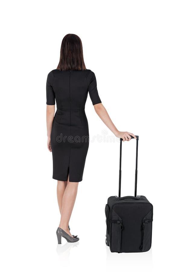 Geïsoleerde vrouw met koffer stock fotografie
