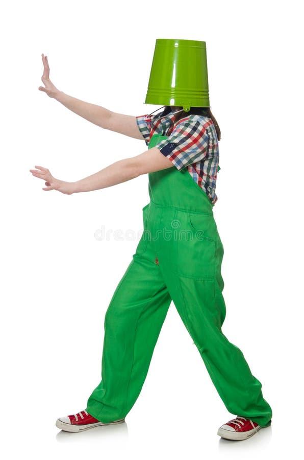 geïsoleerde vrouwelijke werknemer met emmer op haar hoofd royalty-vrije stock afbeelding