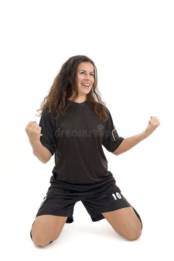 Geïsoleerde vrouwenvoetballer stock afbeelding