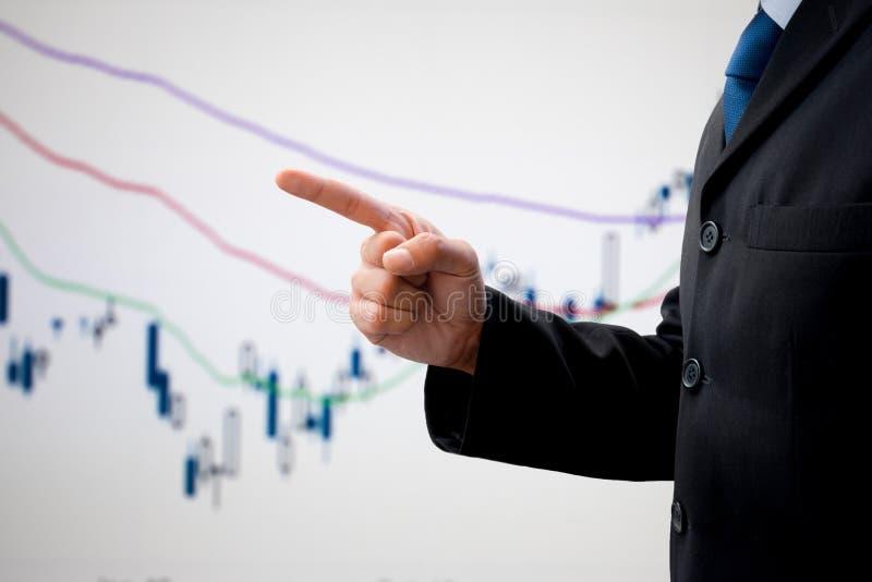Geïsoleerde zakenman die aan zijn succes richten stock afbeelding