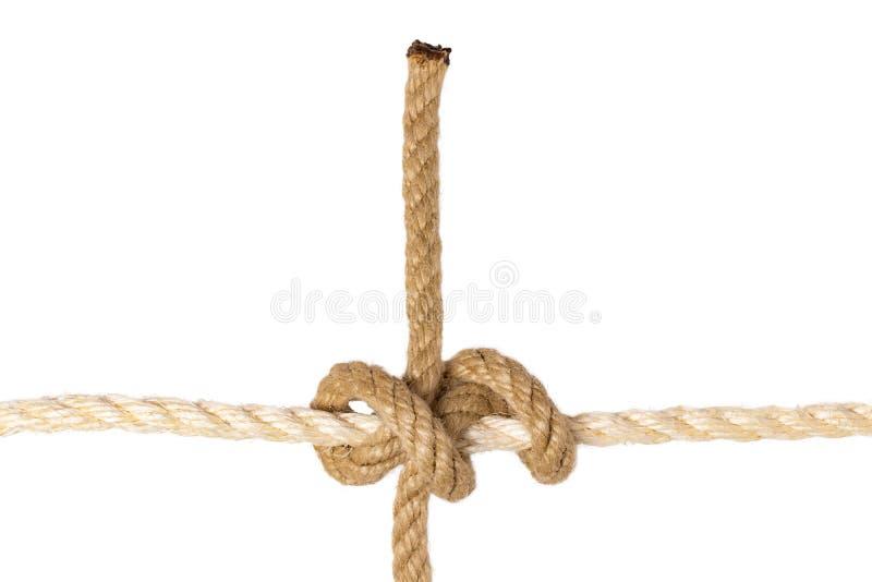 Geïsoleerdeb kabel Close-up van knoop of knoop van de cijfer de de rollende hapering van een bruine kabel die op een witte achter royalty-vrije stock afbeelding