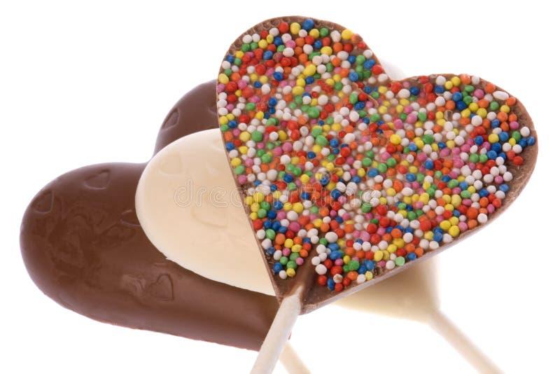 Geïsoleerdee de Lollys van de chocolade royalty-vrije stock fotografie