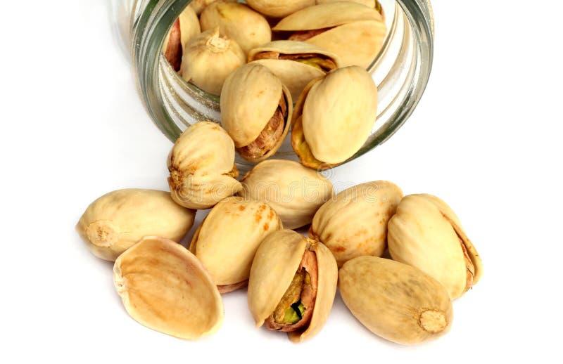 Geïsoleerdee de noten van de pistache stock afbeeldingen
