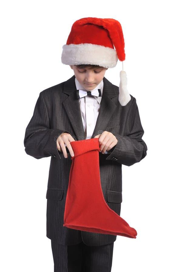 Geïsoleerdee jongen met rode hoed en rode sok, royalty-vrije stock foto