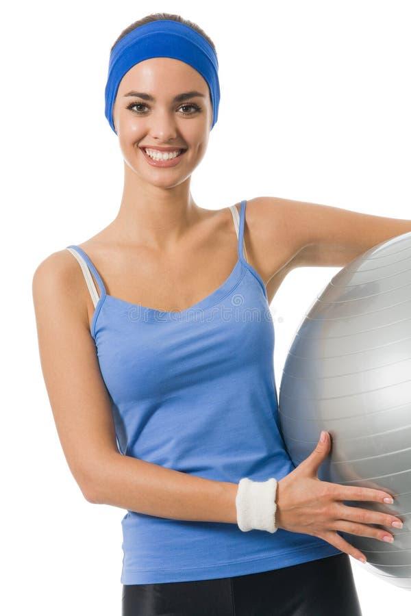 Geïsoleerdee vrouw met geschiktheid-bal, stock afbeelding